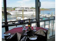 """Mattakeese Wharf Waterfront Restaurant on Cape Cod. Time and history relate to much of this locality and with wind, sea and sand dunes, the """"Mattakeese Wharf"""" tries to bring a little history to the interested diner.    Romantic dining   Sunset dining   Waterfront Dining   Seafood"""