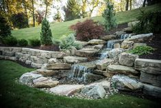 Ponds & Waterscapes Whoever thought that an outdoor paradise could be affordably established in your own yard? Everybody has that piece of land that is either unsightly, has poor drainage, or i… Sloped Backyard, Backyard Water Feature, Sloped Garden, Ponds Backyard, Backyard Waterfalls, Backyard Stream, Backyard Drainage, Garden Ponds, Koi Ponds