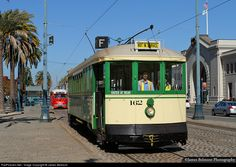 Pictured during an employee training run, San Francisco MUNI street car 162 rolls south along the Embarcadero at the Ferry Building. The 162 was built by Jewett Car Co. in Ohio for MUNI in 1914.