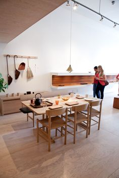Add Some Warmth: 12 Plywood Interiors \\\ The Toronto shop Mjölk, which sells classic and current furniture and hand crafted goods from Scandinavian and Japanese designer, has a floor of large sheets of plywood.