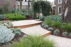 Love the mix of plant beds, patio-ish gravel areas, steps, metal edging