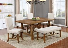 YU201 – Yosemite Honey Walnut 6 Pcs Dining Room Set   Decorate your dining space with this Yosemite Honey Walnut wood finish. Its honey walnut and beige colored fabric will bring a down to earth and rustic look into your dining room. This set Is made of solid wood with veneered. All pieces have champagne colored nail heads, and chairs are upholstered in natural soft beige fabric.