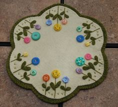 Vintage Button Flower Penny Wool Candle Mat by ThePetiteStudio 2019 Vintage Button Flower Penny Wool Candle Mat by ThePetiteStudio The post Vintage Button Flower Penny Wool Candle Mat by ThePetiteStudio 2019 appeared first on Wool Diy. Penny Rug Patterns, Wool Applique Patterns, Felt Applique, Print Patterns, Felted Wool Crafts, Felt Crafts, Fabric Crafts, Sewing Crafts, Penny Rugs