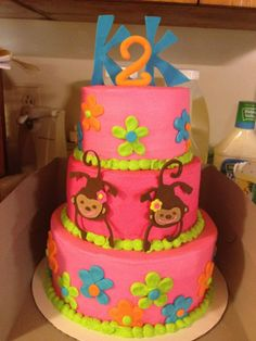 """Monkey Love cake - 3 tiered """"monkey love"""" cake inspired by their birthday invitations and decor.  This cake was for twin girls turning 2.  All buttercream, minus the monkeys, the initials, and the number 2."""