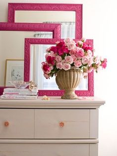 Layered frames in any color would be a cute idea in any bedroom.