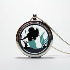 The Little Mermaid Papercut Pendant by Studio Charley, the perfect gift for Explore more unique gifts in our curated marketplace. Mermaid Under The Sea, The Little Mermaid, Mermaid Tale, Floating Lockets, White Gift Boxes, Cute Diys, Dainty Jewelry, Diy Necklace, Paper Cutting