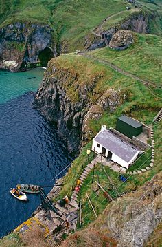 Cottage and Harbor, Carrick-a-rede, Ireland. Let me sail here before I die!
