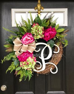 NEW ITEM! This GORGEOUS spring wreath is awaiting your door! Shown on a 18 grapevine wreath with moss, mixed greens of ferns, ivys, ficus, hydrangeas leaves and more! Gorgeous fuchsia peonies with green/pink hydrangeas make this spring door wreath so pretty and bright! Beautiful wreath for spring! A decorative satin cream burlap bow and white 12 script monogram makes this wreath so gorgeous and gives this wreath a personal touch! Measures approx 28x 25X 7 (tip to tip). Will last for...