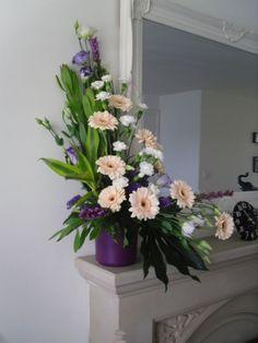 L-shaped Flower Arrangements   Via Jazmine Sherman