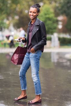 Leather jacket, light skinny jeans, burgundy top, flats.