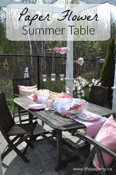 Paper Flower Summer Table: an expensive and beautiful table made with giant paper flowers, sure to wow your guests and keep you on budget.