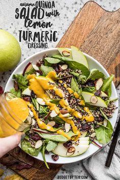 Balance out the heavier cooked down and roasted flavors of fall with this light and tangy Autumn Quinoa Salad with homemade Lemon Turmeric Dressing. Budgetbytes.com #salad #vegan