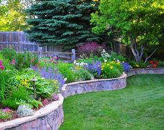 perennial garden and stone wall as natural fence