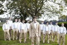 Mixed bow ties and suspenders make for a stylish and standout spring wedding party. Country Groom from rusticweddingchic.com