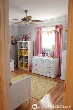 Once a precious pink and grey nursery, see the updates made to create a fun pink and yellow toddler bedroom for a growing toddler girl!