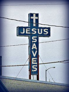 Jesus Saves -    		Neon sign on the roof of a city mission in north Topeka, Kansas
