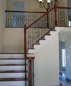 Wood Staircase with Iron Spindles. See more staircase designs and pictures at Stair.com.