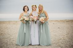 Bohemian wedding dress from Grace loves Lace at a laid back coastal beach wedding in Cornwall. Bridesmaids wear duck egg blue dresses from H&M and groomsmen wear jeans, flip flops and braces.