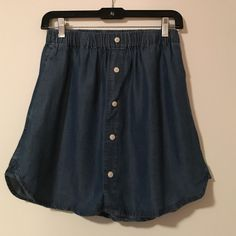 Urban Outfitters BDG Denim Skirt Size Medium LIKE NEW: Urban Outfitters BDG. Brand Size Medium Denim Flow Button Mini Skirt. Deep blue color with just buttons on the front of the skirt. Has pockets on both sides too!! Urban Outfitters Skirts Mini