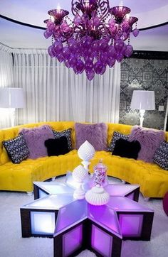 Ok I LOVE the table and the chandelier is cool...also love the ceiling.  The couch has a great shape but  thinking substitute a gray couch and the wallpaper for solid gray walls, maybe lose the patterned pillows? Then do gray sheers and maybe purple lamp shades....Living rooms design ideas