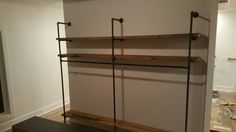Black iron pipe closet shelves and hanging rods