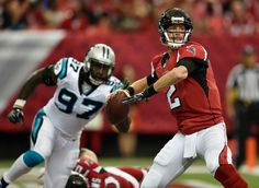 Atlanta Falcons quarterback Matt Ryan (2) works in the backfield as Carolina Panthers defensive end Mario Addison (97) defends during the first half of an NFL football game, Sunday, Oct. 2, 2016, in Atlanta.