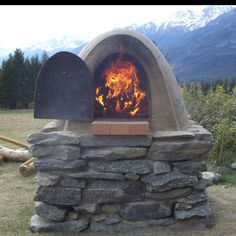 Awesome cob oven~ Love the mountains in the back ground <3