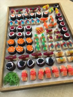 Dessert sushi made of candy and rice crispies to look like nigiri and brownie bites to look like maki. Frushi; candy sushi; sweet sushi