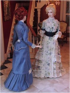 Trish and Jen, dressed in 1898 Spring costume. Porcelain miniature dolls by Annemarie Kwikkel.
