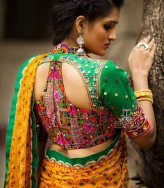 Blouse back neck designs are everything when it comes to picking a good blouse. Here are 40 latest blouse back neck designs that will inspire you to stitch the best blouse for your big day! Blouse Back Neck Designs, Fancy Blouse Designs, Choli Designs, Blouse Designs Catalogue, Stylish Blouse Design, Blouse Models, Saree Blouse, Lace Saree, Silk Sarees
