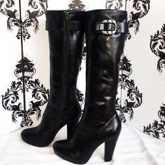 Calvin Klein Black knee high boots Super sleek and classy Brand New Calvin Klein Black heel boots with a silver buckle that says Calvin Klein, both boots have zippers on the sides that zip all the way down. The soles of the boots also continuously Say Calvin Klein. Only worn once. Smoke free home. Calvin Klein Shoes Heeled Boots