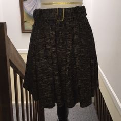 """NWT Burberry Brit Tweed Skirt Burberry Brit Brown Tweed Skirt Flirty pleats and a self-belt add femininity to a borrowed-from-the-boys tweed fabrication.   Belted waist; pleated style; exposed back zip; about 24"""" long. Size 10.  Cotton/wool. Dry clean; Imported;. Color: DARK CAMEL  Brand New With Tags, originally $465.  Shown with Gucci clogs and Burberry blazer, also available. Burberry Skirts"""