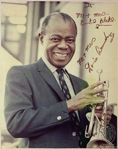 "A fantastic photo of Armstrong circa the early inscribed and signed by the legendary Jazz trumpeter in black felt tip, with ""Satchmo"" added by him on the trumpet. Louis Armstrong, Jazz Artists, Jazz Musicians, Music Artists, Music Love, Music Is Life, My Music, Reggae Music, What A Wonderful World"