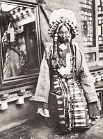 LHASA, TIBET, CHINA.   A general's wife is bedecked in pearls, jewels, and gold. Shaoching H. Chuan.