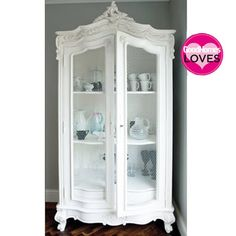 Provencal Wire Showcase Armoire. Hand carved from mahogany and hand finished in a gently distressed antique white.