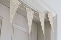 Detail on the vintage book bunting. I like the way twoandsix have stitched the top with red thread
