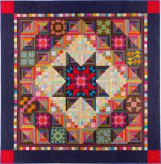 I love the combination of log cabin blocks with other blocks to create lights, brights, and shadows.  From http://littlewelshquiltsandothertraditions.blogspot.com/2013/12/christmas-quilts.html.  Christmas Quilts