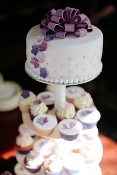 Purple wedding cake with cupcakes. I think something like this but with your theme/style. would be more simple @Holly Dale