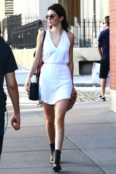 A simple white dress is perfect for Summer. Kendall looks chic as always! 41 of kendall jenner's chicest looks