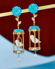 It is the year of the statement earring, after all. L'Artigiano birdcage earrings