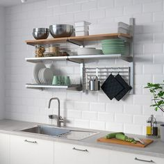 KUNGSFORS Wall grid with storage, stainless steel, ash. Inspired by professionals, adapted for you. Just like in a restaurant kitchen, we've focused on durable materials and smart wall storage. Kitchen Wall Storage, Ikea Kitchen Shelves, Stainless Steel Brackets, Dish Drainers, Best Ikea, Restaurant Kitchen, Wall Racks, Storage Racks, Storage Shelving
