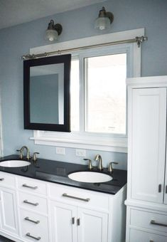 19 Bathroom renovation with movable mirror, by Since I Became a Mom featured on @Remodelaholic