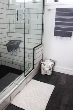 A beautiful modern bathroom renovation with chrome and matte black faucets, sleek modern fixtures and natural wood accents. Diy Bathroom Remodel, Bathroom Renovations, Bathroom Trends, Bathroom Ideas, Bathroom Makeovers, Bathroom Layout, Bathroom Designs, Modern Master Bathroom, Small Bathroom