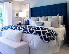 Beautiful bedroom featuring tufted wingback headboard in blue linette fabric