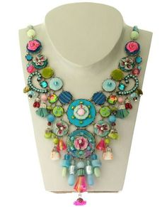 Really pretty use of colour and buttons used in an inventive way with beads. Love it!