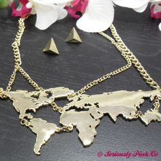 International love...for my ladies that gravitate towards unique pieces then add this one to your collection.  NK00015G - Necklace - World Map from Seriously Pink for $13 on Square Market