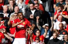 Manchester United's Anthony Martial celebrates scoring the opening goal, minutes after coming on as substituteagainst Stoke City at Old Trafford. Joe Allen equalised for Stoke in the 82nd minute for the draw. United have won 13 points from their opening seven games this season; three fewer than their total at this stage of 2015-16 under Louis van Gaal