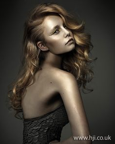2012 womens long curly hairstyle    Long blonde hair was prepped with mousse and roughly blow-dried, using a large round brush to smooth out the hair and add a curl through the ends.     Hairstyle by: Barney Gleeson  Hairstyle picture by: Meiji Nyugen  Salon: Lee Preston  Location: Australia