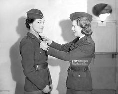 Jan. 1942 - The first military uniforms for American women has been designed in London for women drivers of the American Military Mission. Designed by Major Horner, quartermaster of the Mission, it is a smart uniform in two colours on the lines of the Ameriacn Army uniform. The tunic is of khaki cloth and the skirt of a lighter shade. The shoulder flash in red bears the initials 'U.S.A.'. The smart forage cap is marked with the letters 'U.S.'