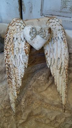 White rusty metal wings with rhinestone embellished heart shabby chic cottage sculpture anita spero: Shabby Chic Cottage, Shabby Chic Decor, Angel Wings Wall Decor, Metal Wings, Driven By Decor, Wreath Drawing, Heart With Wings, Rusty Metal, Angel Art